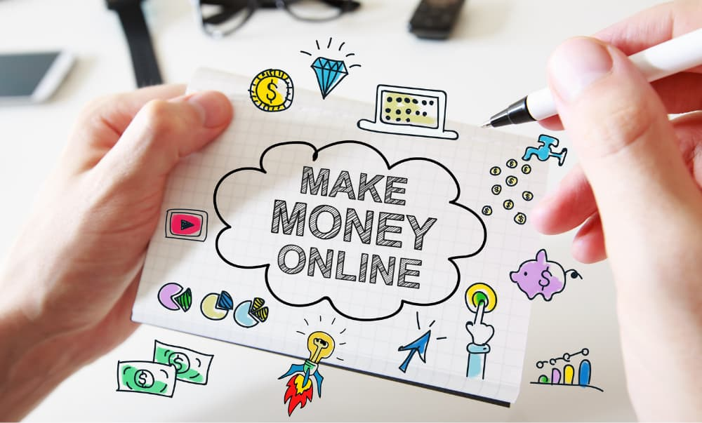 Man with pen writing make money online on a piece of paper