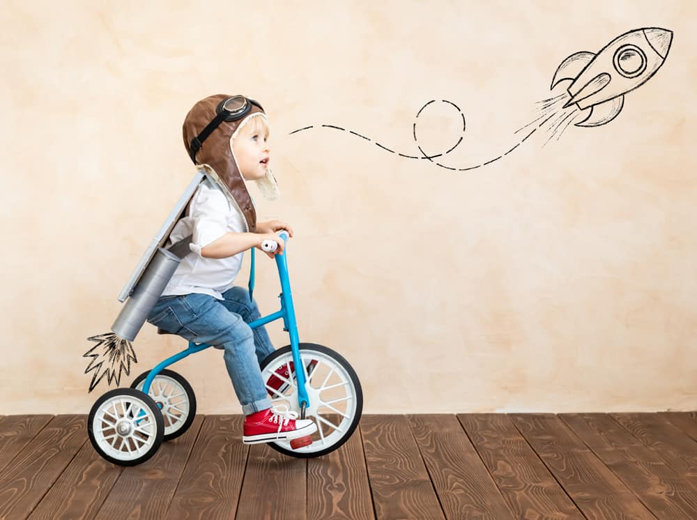 Boy on bike with toy rocket