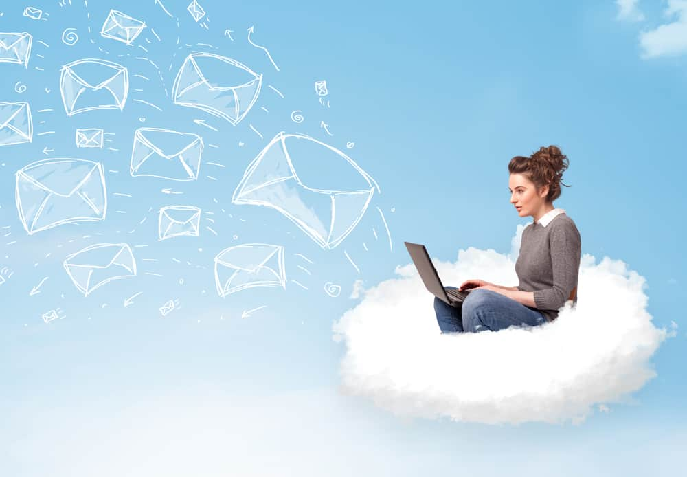 Young woman sitting in cloud with laptop build an email list